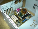 Motherboard in place (ASUS CUSL2 at the time). You can see my 'golden orb' too. It has since been replaced w/ an Alpha.