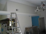 day 6:  i hate cathedral ceilings now.. that ladder is 8' and closer in the picture... 2 coats latter w/ rollers, we gave up. we're renting a spray gun. cathedral style high-vaulted cielings w/ popcorn acoustical finish.. pfft.. and this is room 1 of 3 like this..