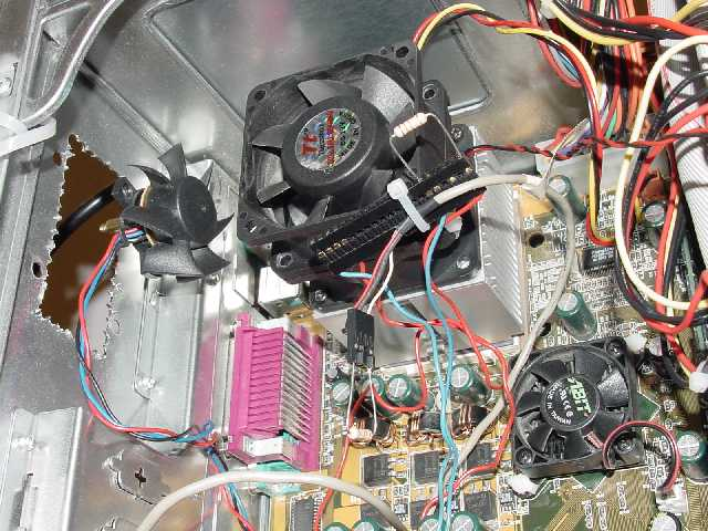 This is JJ's crazy ass FanStack.  He took 2 Volcano 2's and stole the fan off one and stacked it on top of the other.  By doing this he reduced the temperature by 30 degrees on his Athlon 850.