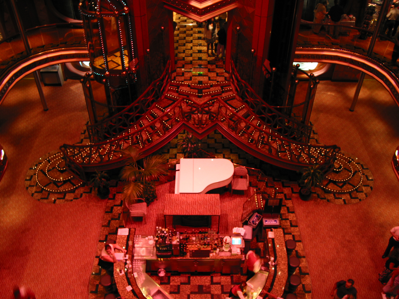 'The Avery' ground level w/ the stair case, piano, and bar.
