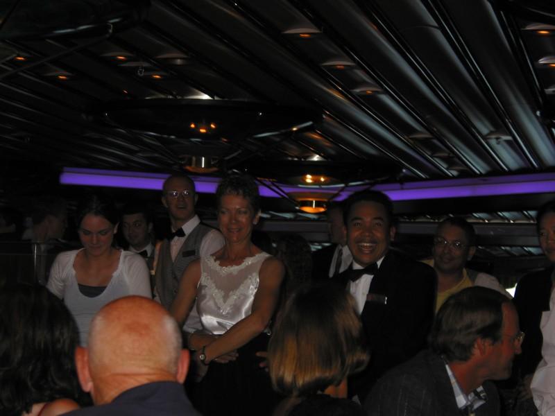 Samantha, Joyce, and our waiter doing the 'Macorena'.